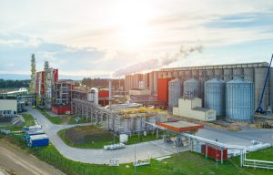 Photo of a sunset over a biofuel factory